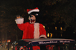 Ole Miss' Rebel the Bear mascot rides in the Christmas parade in Oxford, Miss. on Monday, December 3, 2012.