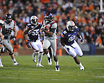 Ole Miss' Brandon Bolden (34) runs vs. Auburn defensive tackle Kenneth Carter (92) at Jordan-Hare Stadium in Auburn, Ala. on Saturday, October 29, 2011. .