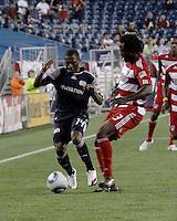 FC Dallas defender Ugo Ihemelu (3) tackles FC Dallas defender George John(14).  The New England Revolution drew FC Dallas 1-1, at Gillette Stadium on May 1, 2010