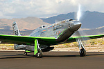 A highly modified P-51D Mustang, owned by Ron Buccerelli and named &quot;Precious Metal,&quot; taxies along the ramp at Stead Field in Nevada following the 2007 Reno Air Races. Modified for racing the standard Rolls Royce Merlin motor has been replaced by a Rolls Royce Griffon motor that includes contra rotating propellers as well as a smaller canopy.  Photographed 09/07