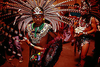 Young Hoopa Indian is dressed in feathers and ceremonial clothing for a native dance performance at a Pow Wow. The Hoopa Valley Reservation is located in Humboldt County with over 2,000 Native American Indians.