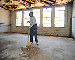 Peggie Gillom was among volunteers working at the Gordon Schools clean-up on Monday, January 18, 2010 in Abbeville, Miss..