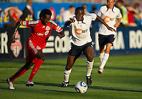21 July 2010:   Bolton Wanderers midfielder Fabrice Muamba No. 6 and Toronto FC forward Fuad Ibrahim No. 7 in action during the Carlsberg Cup game between the Bolton Wanderers and Toronto FC at BMO Field in Toronto..Bolton Wanderers FC  won on penalties.