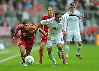 FUSSBALL   1. BUNDESLIGA  SAISON 2011/2012   23. Spieltag  26.02.2012 FC Bayern Muenchen - FC Schalke 04        Philipp Lahm (li, FC Bayern Muenchen) gegen Jefferson Farfan (re, FC Schalke 04)