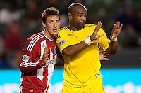 Columbus Crew forward Emilio Renteria (20) gets shoved by defender Ben Zemansk (21) of Chivas USA. Chivas USA and Columbus Crew played to a 0-0 tie at Home Depot Center stadium in Carson, California on  April  9, 2011....