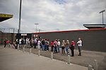 Fans queueing at the turnstiles at Seaview Park, Belfast before Northern Irish club Crusaders take on Fulham in a UEFA Europa League 2nd qualifying round, fist leg match. The visitors from England won by 3 goals to 1 before a crowd of 3011.
