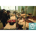 March 20th, 1995 : Patients from the sarin gas attack laying down in the church of Saint Luke's International Hospital in Tokyo, Japan. (Photo by Ryuzo Suzuki)