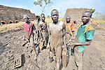 Men who form mud into blocks that will be fired into bricks outside Minyori, a small village in Central Equatoria State in Southern Sudan.