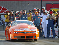 Oct 29, 2016; Las Vegas, NV, USA; Crew members dressed up in costume with NHRA pro stock driver Bo Butner and his Dukes of Hazzard themed car during qualifying for the Toyota Nationals at The Strip at Las Vegas Motor Speedway. Mandatory Credit: Mark J. Rebilas-USA TODAY Sports