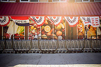 Carts in front of a grand opening of a supermarket in Harlem in New York on Saturday, August 24, 2013. (© Richard B. Levine)