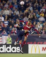 New England Revolution defender Darrius Barnes (25) and Real Salt Lake forward Alvaro Saborio (15) battle for head ball. Real Salt Lake defeated the New England Revolution, 2-1, at Gillette Stadium on October 2, 2010.