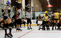 Outside pack referees Shaolin Punk, Dr. Evil, and Frisky Dingo stand in position before the jam starts.  Ivanna Cocktail stands behind the pack as an Outside White Board NSO.