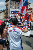 Thousands turn out for the Brooklyn Puerto Rican Day Parade in the Bushwick neighborhood of Brooklyn in New York on Sunday, June 2, 2013. As more and more hipsters move into the neighborhood the ethnicity of the area is changing.   (© Richard B. Levine)