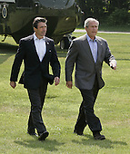 Camp David, MD - June 9, 2006 -- United States President   George W. Bush, with Danish Prime Minister Anders Fogh Rasmussen, walk to a joint press conference at Camp David, Maryland Friday 09 June 2006. President Bush plans to mix discussions on international issues with outdoor exercise as he hosts fellow fitness buff, the prime minister of Denmark, at Camp David..Credit: Shawn Thew - Pool via CNP