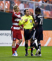 Joseph Ngwenya (11) of D.C. United argues with Brek Shea (20) of FC Dallas with referee Baldomero Toledo in between during the game at RFK Stadium in Washington, DC.  D.C. United tied FC Dallas, 0-0.