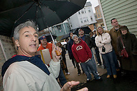 12 March 2006 - Kearny, NJ - Participants in a bus tour of locations featured in the hit television mob show The Sopranos listens to the tour guide Marc Baron (L) talk about a scene shot in the alley in Kearny, USA, 12 March 2006.