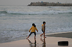 Palestinian children enjoy their time during sunset at the beach of Gaza sea on January 31, 2015. Photo by Mohammed Asad