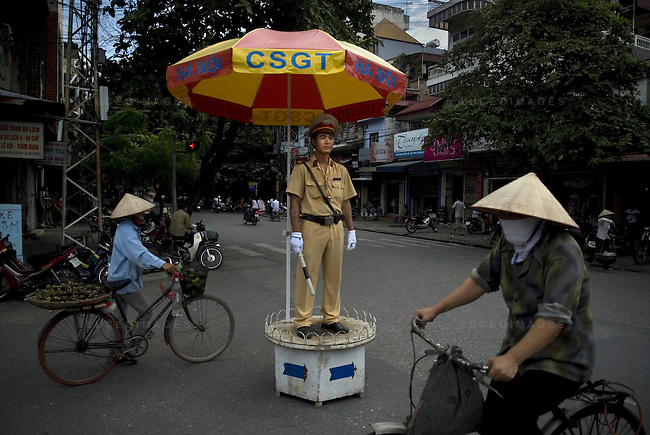 A north Vietnamese police officer directs traffic in Hanoi.
