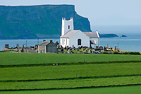 Bushmills, Northern Ireland, United Kingdom, May 2011. Ballintoy Church on the edge of the coastline. For decades travellers stayed away from the sectarian violence, but since the end of'The Troubles' more and more people start discoving the beauty of Belfast and the Antrim Coast Causeway. Photo by Frits Meyst/Adventure4ever.com