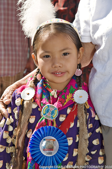 Young Heaven Old Coyote nestles next to her great grandmother while waiting to participate in the Native AMerican costuem contest at the 2008 Santa Fe Indian Market.