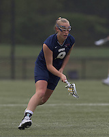 University of New Hampshire midfielder Ilana Cohen (9) scoops up ground ball. Boston College defeated University of New Hampshire, 11-6, at Newton Campus Field, May 1, 2012.