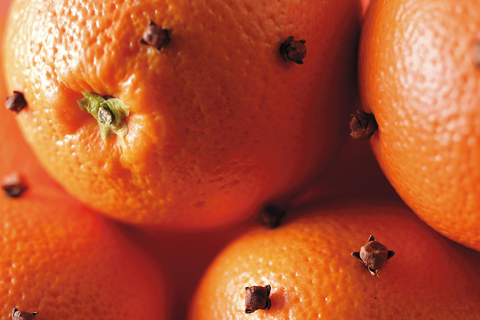 Whole oranges studded with cloves