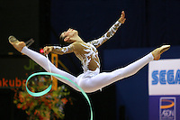 Daria Kushnerova of Ukraine split leaps with ribbon at 2006 Aeon Cup Worldwide Club Championships in rhythmic gymnastics on November 16, 2006 at Mie, Japan. (Photo note: Reload of earlier, little more contrast this version.)