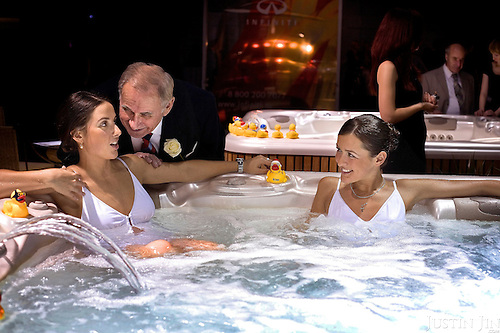 A male visitor at the Millionaire Fair in Moscow approaches female sales assistants bathing in whirlpools. .Millionaires, billionaires and those who bought 1,000-rouble tickets were among the thousands who visited the fair held in the Crocus city expo centre. .The four-day event, held for the second year in a row, ended on October 30. The products on sale include a diamond-studded mobile phone worth a million dollars, an island, latest sports cars and other items that might appeal to the growing millionaire market..Twenty years ago, there were no official millionaires in the whole of Russia. Now Moscow has 25 billionaires and the country has 88,000 millionaires, according to Forbes Magazine. ..