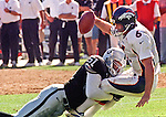 Oakland Raiders vs. Denver Broncos at Oakland Alameda County Coliseum Sunday, September 20, 1998.  Broncos beat Raiders  34-17.  Oakland Raiders defensive end Lance Johnstone (51) sacks Denver Broncos quarterback Bubby Brister (6).