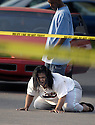 Joe Imel/Daiy News.Lakiesha Covington falls to the ground after finding out that her brother Jamal Covington and his pregnant girlfriend had been found shot to death execution style in a drug related murder at Willow Creek Apartments. Gilbert U. Holts, Jr. was charged with the murders. The man in the background is unidentified. .