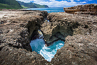 A heart-shaped rock configuration filled with gushing water from the ocean on the west side of O'ahu.