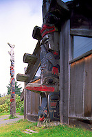 Old Masset, Haida Gwaii (Queen Charlotte Islands), Northern BC, British Columbia, Canada - Totem Poles and Longhouse - prior to fire that destroyed longhouse and totem pole