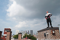 Real life Super Hero Crimson Fist roams the streets of Atlanta's Castleberry Hill neighborhood.