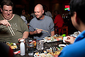Greg Camonte, left, explains his plan of attach to Josh Uronis, who was guilted into taking on the Sushi Challenge at Kanki Japanese House of Steaks and Sushi, Durham, NC, March 19, 2012. Camonte was victorious, Uronis was not.