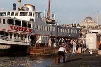 General view of Golden Horn ferry and passengers at the quayside with Suleymaniye Mosque in the background,  Istanbul, Turkey. Picture by Manuel Cohen.