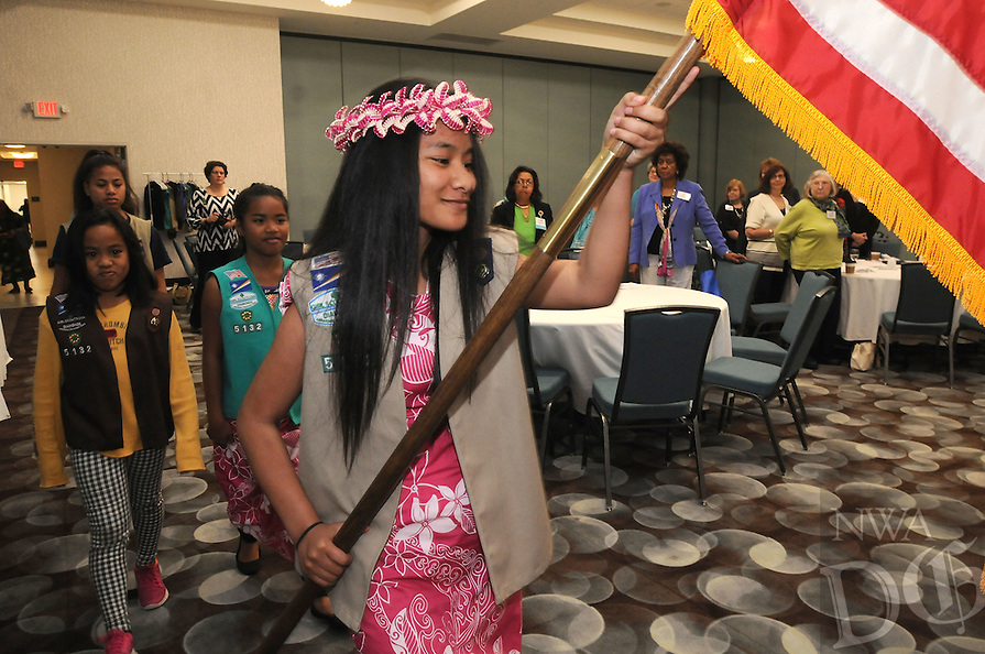 NWA Democrat-Gazette/FLIP PUTTHOFF <br /> Henity Harry (cq) brings the American Flag on Saturday April 30, 2016 into the convention of the American Association of University Women. Girl Scouts from Troop 5132 in Springdale posted the colors at the gathering.