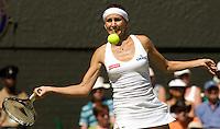 Gisela Dulko (ARG) against Maria Sharapova (Rus) (24) in the second round of the ladies singles. Dulko beat Sharapova 6-2 3-6 6-4..Tennis - Wimbledon - Day 3 - Wed  24th June 2009 - All England Lawn Tennis Club  - Wimbledon - London - United Kingdom..Frey Images, Barry House, 20-22 Worple Road, London, SW19 4DH.Tel - +44 20 8947 0100.Cell - +44 7843 383 012