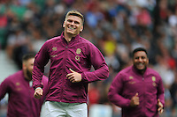 Owen Farrell of England is all smiles on the sidelines. QBE International match between England and Ireland on September 5, 2015 at Twickenham Stadium in London, England. Photo by: Patrick Khachfe / Onside Images
