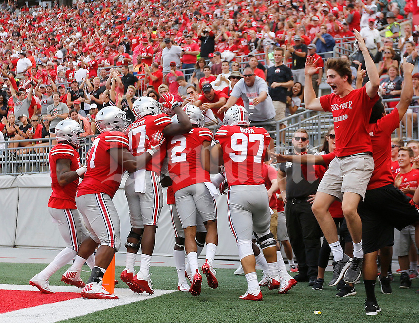 The defense celebrates after Ohio State Buckeyes safety Malik Hooker (24) returned an interception for a touchdown during the second quarter of the NCAA football game between the Ohio State Buckeyes and the Tulsa Golden Hurricane at Ohio Stadium on Saturday, September 10, 2016. (Columbus Dispatch photo by Jonathan Quilter)