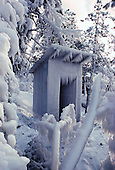 Ice covered outhouse.