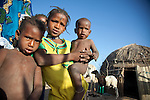 Fulani children in the seasonal village of Bantagiri in northern Burkina Faso.  The Fulani are traditionally nomadic pastoralists, crisscrossing the Sahel season after season in search of fresh water and green pastures for their cattle and other livestock.