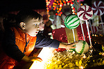 Carter Newhauser of Redwood City is dazzled by the candy on a float featured in the Festival of Lights Parade.