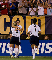 Megan Rapinoe (11) celebrates her goal with USWNT teammates Amy Rodriguez (8) and Shannon Boxx (7) at Rentschler Field in East Hartford, Connecticut.  The USWNT defeated Sweden, 3-0.