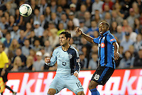 Benny Feilhaber (10) midfield Sporting KC watches the ball with Colleen Warner (18) midfield Montreal Impact .<br />