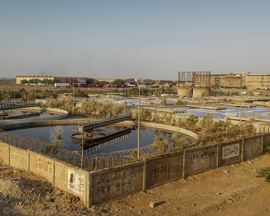 Scene from Karachi's industrial area Korangi - the tanneries can be seen in the background. A recently built effluent treatment plant sits in the foreground, though the issue of water pollution, and chemical sewage pouring straight into the Arabian sea remains.
