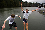 Drew Irvine (L) and Mike Viatore (R)  jump off a bridge during the 26th annual Polar Bear jump into the Burley Lagoon in Olalla, Washington on 1 January  2010. Over 300 hardy participants  braved the chilly lagoon waters to join in on the annual New Year's Day Tradition.  Jim Bryant Photo. ©2010. ALL RIGHTS RESERVED.