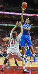 UK junior center DeNesha Stallworth lofts the ball over the defense of senior forward Monique Reid. in Louisville, Ky., on Sunday, December, 2, 2012. Photo by James Holt | Staff