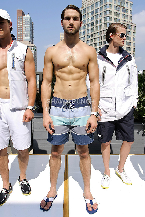Jamie Jewitt poses in a naval blue striped cotton/nylon twill swim trunk from the Nautica Men's Spring 2013 collection by Chris Cox, during New York Fashion Week Spring 2013, September 7, 2012.