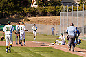 San Marin second baseman Chris Glennon collides with Acalanes baserunner Paul Nork during the North Coast Section Division 3 final at San Marin High School on June 7, 2011. Novato Fire District offficers took Nork to a local hospital. The game ended in a 4-4 time after officials suspended the game due to darkness after 10 innings. NCS officials declared both teams Co-champions.