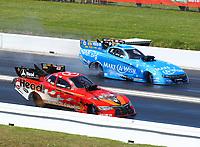 Apr 23, 2017; Baytown, TX, USA; NHRA funny car driver Jonnie Lindberg (near) races alongside Tommy Johnson Jr during the Springnationals at Royal Purple Raceway. Mandatory Credit: Mark J. Rebilas-USA TODAY Sports